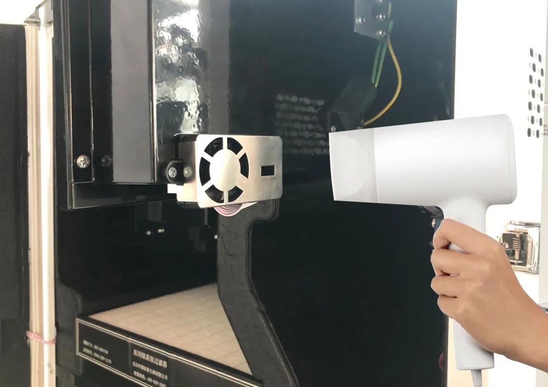 Hair Dryer to clean sensor.webp
